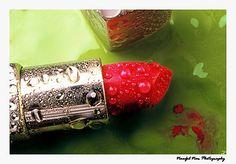 Red Lipstick against Green Paint BckGrnd