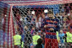 "Barcelona's defender Gerard Pique (R) cuts the net of the goal as Messi's son looks at him after winning the Spanish ""Copa del Rey"" (King's Cup)…"