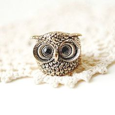 A small tattoo of this owl would be so cute!