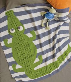 Super cute crocodile afghan! #knitting #stripes