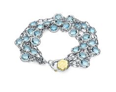 #Tacori #FallBling SB100Y02 Like the beautiful waves of the ocean water, this piece will immediately make you feel calm and serene. Light Blue Topaz gems sit inside strands of .925 silver circlets, for a look that says daytime casual or night time flair. Completed with an 18k yellow gold gemseal toggle- Tacori Fall Bling