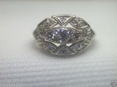 8 princess diamonds x. wide front face of ring (across top to bottom). Diamond Information. Old Jewelry, Art Deco Jewelry, High Jewelry, Antique Jewelry, Vintage Jewelry, Antique Art, Art Deco Diamond, Solitaire Diamond, Filigree Engagement Ring