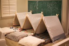 I wanted each of them to have their own little space--so we created these A-frame tents, placed a mattress inside, made up each bed with cozy Indoor Tent For Kids, Kids Bed Tent, Diy Kids Teepee, Diy Teepee Tent, Indoor Tents, Teepee Party, Sleeping Tent, Diy Mattress, A Frame Tent