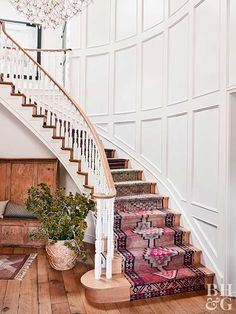 curved staircase with turkish kilim rugs