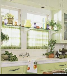 Kitchen window!!! Glass shelf with tension rods underneath...one for sheer curtains that can be pulled open and one in front of curtain rod for s hooks, towel, etc. OR... Wooden shelf/shelves on brackets... ???