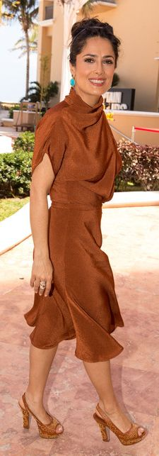 Curvy/Petite Salma Hayek in Gucci.  Fitted waist, flowing over bust & hip for balance.