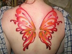 butterfly wings.. :) smaller scale and in black? Possibly some color?