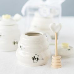 "These honey pot favors are not only adorable, but practical as well. Our ""Sweet as Can Bee"" honey pot design make great baby shower favors."