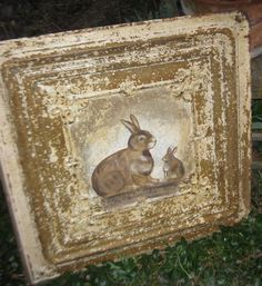 Hand painted rabbits on an antique ceiling tin