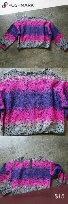 Cropped pink purple sweater small Warm cropped sweater. Purchased in the Philippines. The design looks almost like silly string. Pink purple gray and black. Meant to be a little bloody. Never worn.  No tags but fits like a small. Zipper in the back. Tops Crop Tops
