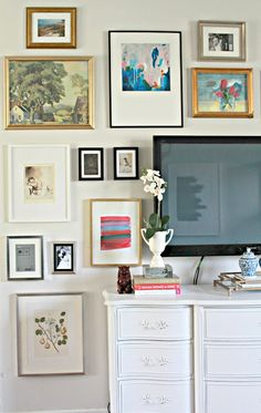wall mounted tv incorporated into gallery wall