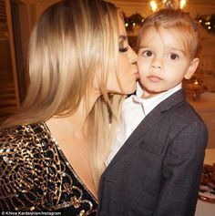 Cute:Khloe also wandered off in search of her nephew - the youngest of Kourtney and Scott Disick's three children and captioned an adorable picture with the two-year-old: 'My Reign'