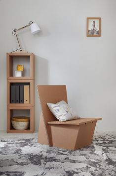 carton furniture from Berlin: lounge chair and book shelf all of cardboard