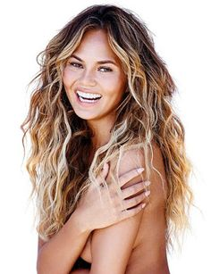 John Legend's wife Chrissy Teigen stripped completely naked for newshoot in Women's Health UKin which sportswomen and celebrities talk about their body insecurities. Former The Only Way Is Essex star Lucy Mecklenburgh also stripped for the magazine. See the photos below..  Lucy  Personal trainer Chloe Madeley 28 also stripped