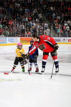 03.01.15 - Erik Burgdoerfer giving a hello to the two Toyota Junior Starters of the game who joined the starting lineup.  Photo courtesy of JustSports Photography