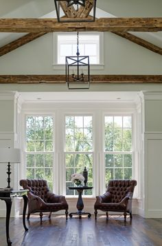 House Tour: American Farmhouse - Design Chic - love a tufted chair in a living room