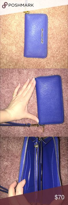 Micheal Kors Cobalt Blue wristlet/wallet Beautiful cobalt blue wallet from MK with detachable wristlet. Only used maybe 2 months, brand new condition. KORS Michael Kors Bags Clutches & Wristlets