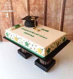 Gold and green fondant rectangle rectangular graduation sheet cake with stars, mortarboard cap and scroll diploma