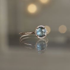 Blue Topaz and Diamond Dainty Halo Ring in 14k Rose Gold at Sarah O. Jewelry | Denver, CO