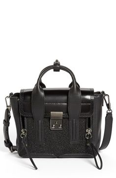 3.1 Phillip Lim 'Pashli - Mini' Glitter Satchel- Details & Care: A glitter-encrusted panel stands out against the smooth leather of a modern satchel in scaled-down proportions. An optional strap allows for instant crossbody carry, while vertical zip gussets and gleaming gunmetal hardware provide a signature finish. Push-lock closure.Optional, adjustable strap.Interior zip pocket.Leather. VIEW MORE INFO HERE: http://www.designerhandbagspurses.net/designer-handbags-are-worth-the-splurge/