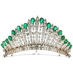 An antique silver, gold, diamond and emerald tiara, about 1910.
