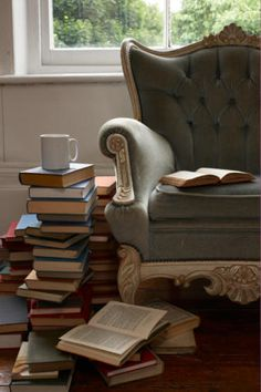blue-grey chair and pile of books