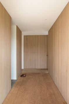 House Olmen,© Frederik Vercruysse, wood panels and cabinetry. Circulation space.
