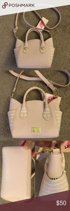 """NWT Betsey Johnson satchel blush kitty face! NWT Betsey Johnson satchel blush kitty face!   - Shape of a cat face and has gold accents.  - Color : blush  - Has two side pockets as well as a handles and a shoulder strap.  - Inside : 1 zipper pocket  - Measurement: approximately 10""""(L) X 7""""(H) X 4.5""""(D)  - Handle straps : 3""""  - Long adjustable strap : 25"""". ( longest)   ** Great Small satchel / Crossbody bag! Betsey Johnson Bags Crossbody Bags"""