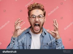 Emotional outraged man gestures angrily, being irritated with loud noise in next room, need to do much work, can`t concentrate, screams loudly in despair. Negative emotions and feelings concept Negative Emotions, Facial Expressions, Scream, Photo Editing, Royalty Free Stock Photos, Cartoons, Faces, Concept, Feelings