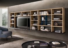Whether you want a wall entertainment center or a custom bar, Pedini Miami has modern and custom wall units solutions to fulfil your needs. Modern Entertainment Center, Modern Wall Units, Bar Station, Glass Rack, Counter Space, Accent Pieces, Home Office, Bookcase, Shelves