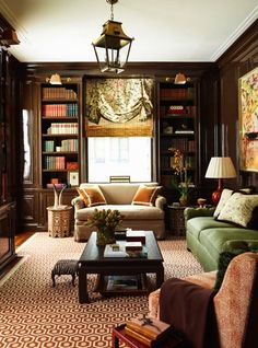 ashley whittaker library/den--lacquered brown walls, geometric rug, ceiling lantern, asian coffee table