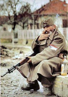 "Serbian ""Chetnik"", with Yugoslavian model 59/66 carbine; a modified copy of the Russian SKS."