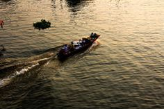 Boat on river with sunset. Royalty Free Stock Photo