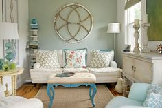 Like the wall color with the blue accents. Small Coastal Home - eclectic - living room - boston - Lisa Teague Studios