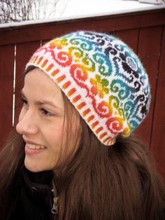 I love this Fair Isle hat design; so clever to use a variegated yarn w/a solid and look at the awesome outcome! Karin Kurbits hat by Johanne Landin.
