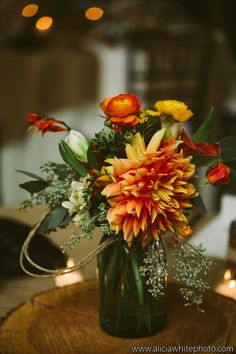 lovely flowers for an October wedding!  Check out this amazing Dahlia! #wedding #flowers #westernNC #weddingvenue #rustic #orangeflowers
