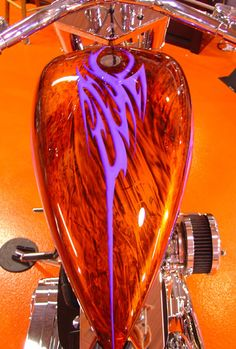 Orange candy pearl marblized with purple airbrushed graphics.  What a ride...