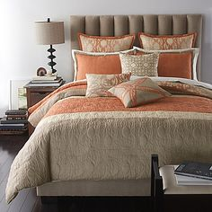 Bring the relaxing look of the shore to your bedroom with the Bryan Keith Del Ray Reversible Comforter Set. This beautifully colored and textured bedding is decorated with patterns and embroidery inspired by the ocean in hues of coral and tan.