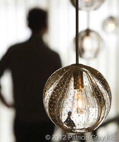 Lighting fixture made of blowned glass.
