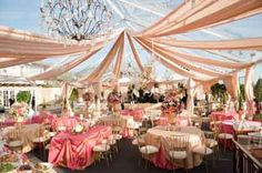 This wedding was shown as a French wedding - but first it is pink; 2nd - I like the old world feel: 3rd- I love the tent and lighting!