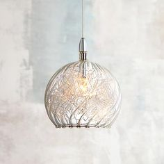 The innovative use of swirl wire glass lends this Possini Euro Design mini pendant light plenty of visual appeal. Comes with of wire. Style # at Lamps Plus.