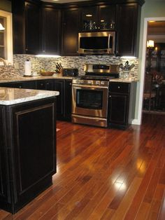 i like the dark cabinets with the stainless steel appliances