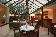 Herodion, a luxury Athens city hotel, with amazing Acropolis views, offering warm hospitality and unique services for a memorable stay. Athens City, Athens Greece, Overstuffed Chairs, Wooden Ceilings, Course Meal, Acropolis, Parquet Flooring, Rustic Walls, Beverage