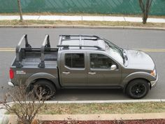 Very good looking Nissan Frontier with bed rack and roof rack.