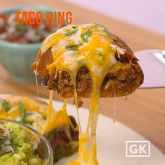 Taco Ring Taco filling nestled in a crescent roll ring. I Love Food, Good Food, Yummy Food, Tasty Videos, Food Videos, Cooking Videos, Great Recipes, Favorite Recipes, Crescent Roll Recipes