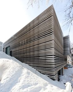 """Architecture firm Kimlim, from St. Gallen, Switzerland, has dressed the new canteen at the high school (Kantonsschule) in highly effective """"clothes"""": a membrane façade made of non-bearing fine ceramic strips"""