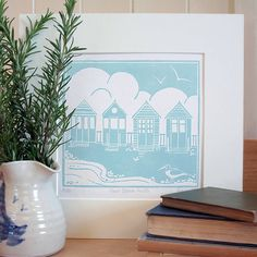 This is an original lino print of a classic British seaside scene - a row of traditional beach huts with a seagull wading in the shallows. It would make a lovely addition to a coastal home or as a present for someone who loves the beach. Each linocut is carefully printed by hand using high quality block printing inks. It comes mounted using a pale cream board, ready for you to frame, and is wrapped in cellophane and tissue. Limited edition of 50 Image size: 18 x 16.5cm Mou... $81.10