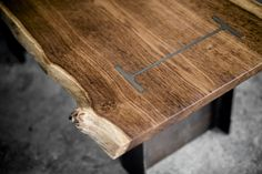 i-beam coffee table par oneoffoak This design is part of my registered designs portfolio (number and fuses a structural steel i-beam with the solid English brown Oak top. Brown oak was chosen.
