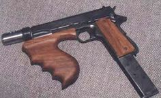 John Dillinger's 1911 Machine Pistol. Altered to fire full auto.