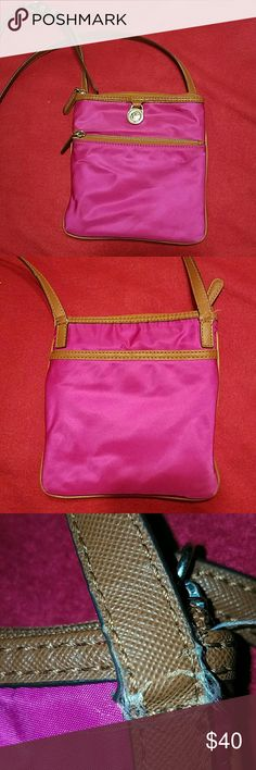 Micheal kors crossbody Pink and brown crossbody bag with 2 zippered compartments.  One compartment has 2 pockets.  Pocket on the back.  Orange lining.  The straps are fraying and creasing.  Look at pictures.  Price reflects MICHAEL Michael Kors Bags Crossbody Bags